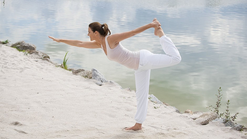 Woman yoga beach sea body